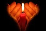 stock-photo-hands-holding-a-burning-candle-in-dark-132429836